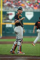 Zack Collins (0) of the Miami Hurricanes looks on during a game between the Miami Hurricanes and Florida Gators at TD Ameritrade Park on June 13, 2015 in Omaha, Nebraska. (Brace Hemmelgarn/Four Seam Images)