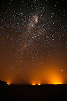 Bush fires at night under the Milky Way