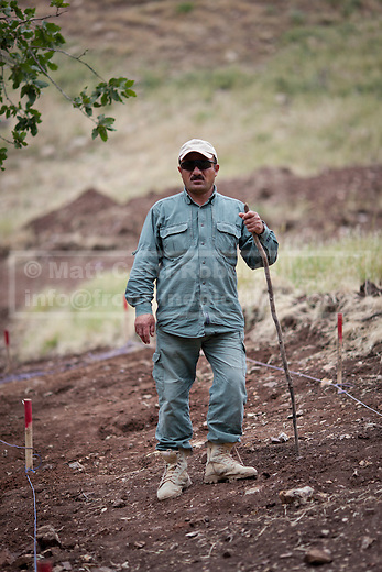 Rafee Ahmed, a mechanical demining team supervisor stands in a safe area in one of three minefields being cleared by the Khabat Zangana Company near Kalawy, in Iraqi-Kurdistan. The three minefields date back to the Iran-Iraq War when the Iranian Army occupied the area for an extended period of time. Two of the minefields were laid by the Iranians to protect their positions, with a third laid by Iraqi forces.