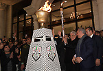 Palestinian President Mahmoud Abbas, light a torch during a ceremony marking the 55th anniversary of Fatah's founding, in the West Bank city of Ramallah, on December 31, 2019. Photo by Thaer Ganaim