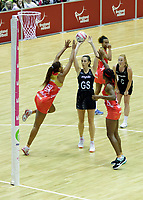 20.01.2018 Bailey Mes of Silver Ferns shoots during the Netball Quad Series netball match between England Roses and Silver Ferns at the Copper Box Arena in London. Mandatory Photo Credit: ©Ben Queenborough/Michael Bradley Photography