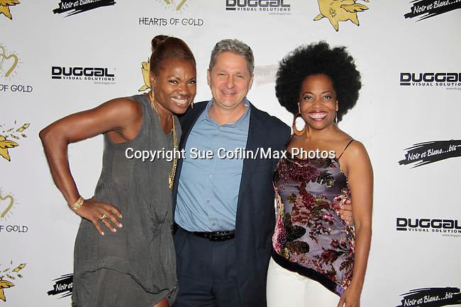 Founder Deborah Koenigsberger poses with her husband Thilo and Another World Rhonda Ross sings at Hearts of Gold - 45 A Different Kind of Fund Raiser on July 10, 2014 at Manhattan Penthouse, New York City, New Yor (Photo by Sue Coflin/Max Photos)