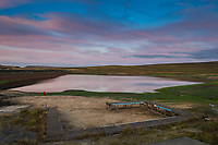 Low water levels can be seen as the sun sets at Redbrook Reservoir, Marsden, West Yorkshire.