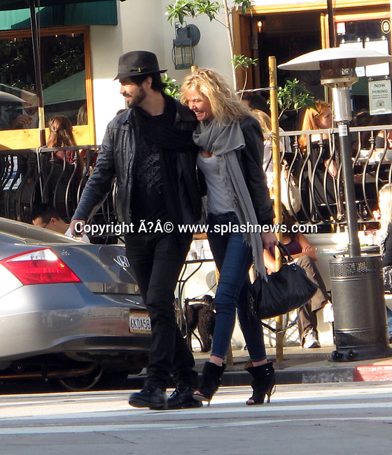EXCLUSIVE: Hunky Canadian actor Antonio Cupo is seeing with Liam Neeson's ex girlfriend, Polish actress Kasia Wolejnio at Urth Cafe in Los Angeles, West Hollywood, CA. Cupo is currently starring in Global's hit TV mini-series, 'Bomb Girls'.<br />