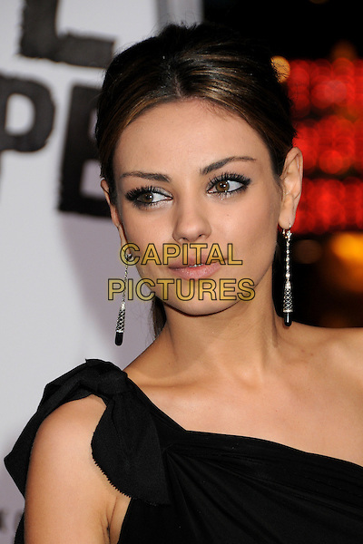 "MILA KUNIS .at Alcon Entertainment's L.A. Premiere of ""The Book of Eli"" held at The Chinese Theatre in Hollywood, California, USA, January 11th 2010. .portrait headshot make-up eyeliner black one shoulder dangly earrings hair up .CAP/ADM/BP.©Byron Purvis/AdMedia/Capital Pictures."