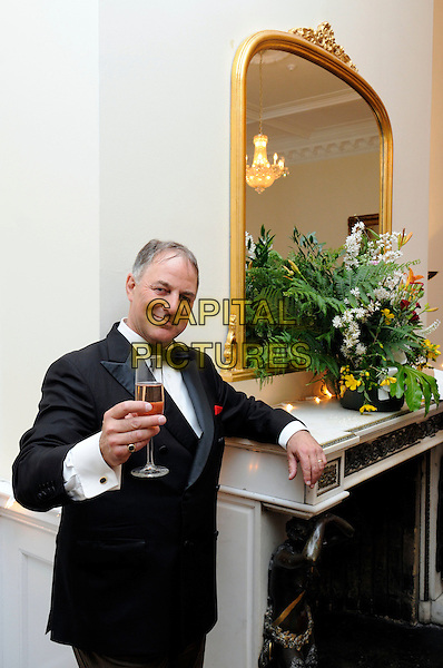 """ANTHONY ADAMS (Frank Sinatra from the BBCs """"The One And Only"""").At """"Lawnfest"""", an open air concert, West Heath School, Sevenoaks, Kent, England..June 25th, 2009.half length black tuxedo glass drink beverage champagne .CAP/FIN.©Steve Finn/Capital Pictures."""