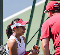 STANFORD, CA - April 1, 2011:  Stacey Tan in a light hearted moment with Associate Head Coach Frankie Brennan during Stanford's 6-1 victory over Arizona State at Stanford, California on April 1, 2011.