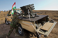 "DIYALA PROVINCE, KURDISTAN. 14.06.14 Members of the Kurdish armed fighters (also known as ""peshmerga"") load up heavy artillary during clashes between Kurdish fighters and ISIS militants. ISIS have gained signifant ground and ammunition since taking over Mosul, Iraq's second largest city."