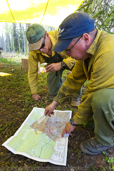 Togie and Dale of the Operations team discuss fire strategy on the Eagle Trail forest fire near Tok, Alaska, May, 2010.