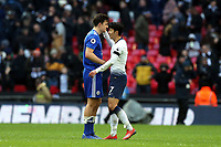 Son Heung-Min of Tottenham Hotspur and Harry Maguire of Leicester City after Tottenham Hotspur vs Leicester City, Premier League Football at Wembley Stadium on 10th February 2019