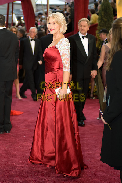 HELEN MIRREN.Arrives at the 80th Annual Academy Awards at the Kodak Theatre in Hollywood, California, USA..February 24th, 2008.oscars full length red satin silk dress silver cropped jacket cardigan clutch bag purse .CAP/A.M.P.A.S./AW.Supplied by AW/A.M.P.A.S./Capital Pictures.