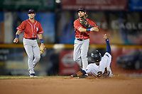 New Hampshire Fisher Cats second baseman Vinny Capra (1) throws to first base as Isiah Gilliam (24) slides in during an with shortstop Logan Warmoth backing up the play Eastern League game against the Trenton Thunder on August 20, 2019 at Arm & Hammer Park in Trenton, New Jersey.  New Hampshire defeated Trenton 7-2.  (Mike Janes/Four Seam Images)
