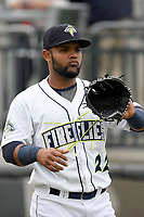 Left fielder Walter Rasquin (22) of the Columbia Fireflies warms up before a game against the Augusta GreenJackets on Saturday, April 7, 2018, at Spirit Communications Park in Columbia, South Carolina. Augusta won, 6-2. (Tom Priddy/Four Seam Images)
