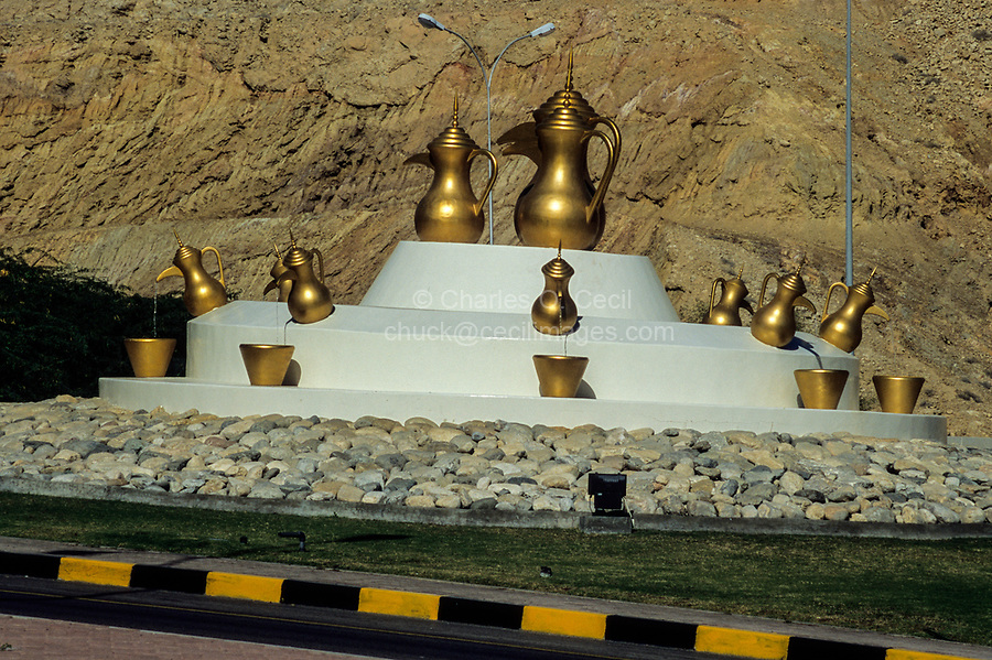 Between Ruwi and al-Bustan, Muscat Capital Area, Oman.  Public Art: Traditional Coffee Pots in a Traffic Roundabout.