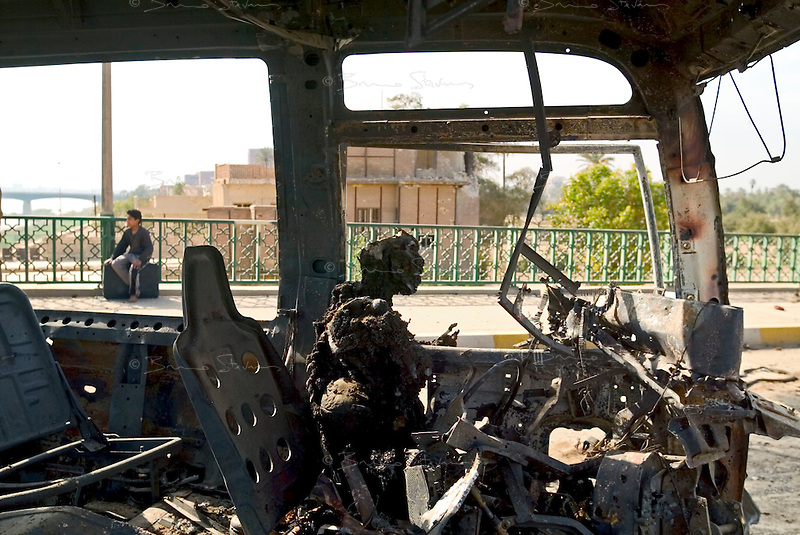 Baghdad, Iraq, April 10, 2003.the charred body of a Saddam fedayin on Senegh bridge bears witness of the violence of the last battle between fanatics of the regime and US Forces entering Baghdad..