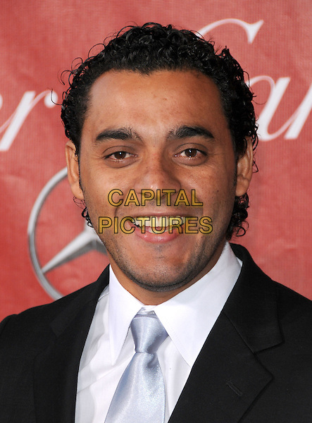 RUI RICARDO DIAZ .2011 Palm Springs International Film Festival Awards Gala held at The Palm Springs Convention Center in Palm Springs, California, USA, .January 8th, 2011.      .portrait headshot smiling white shirt tie smiling black    .CAP/RKE/DVS.©DVS/RockinExposures/Capital Pictures.