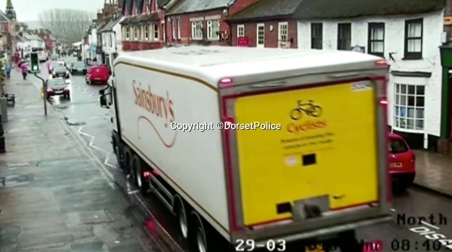 BNPS.co.uk (01202 558833)<br /> Pic: DorsetPolice/BNPS<br /> <br /> Sainsbury's lorry drives up to the crossing...<br /> <br /> Chilling footage of Jaiden Mangan(3) approaching the pedestrian crossing where he was killed by a Sainsbury's lorry in Wareham, Dorset, last year.<br /> <br /> A lorry driver who sarcastically clapped a motorist moments before he knocked down and killed a young boy on a pedestrian crossing was today cleared of causing death by dangerous driving.<br /> <br /> Dean Phoenix admitted he made a mistake by failing to see a red light at the crossing to allow three-year-old Jaiden Mangan and his family walk across.<br /> <br /> Phoenix, 44, pulled away without seeing them and collided with Jaiden, who suffered fatal chest and abdominal injuries.<br /> <br /> A court heard that the Phoenix had been distracted at the time because he was 'sarcastically clapping' another motorist just as he drove off.