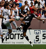 Real Madrid midfielder (23) Esteban Granero goes in on DC United midfielder (7) Fred during their friendly at FedEx Field in Landover, Maryland.  Real Madrid defeated DC United, 3-0.