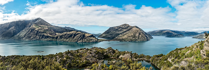 Panorama of Lake Wanaka as seen from the top of Mou Waho, an island in the middle of the lake