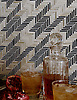 Houndstooth, a handmade mosaic backsplash shown in Jasper and Alabaster jewel glass.