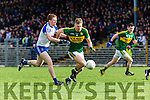 Kerrys Peter Crowley tears through the Monaghan defencerr Kieran Hughes  in Fitzgerald Stadium on Sunday