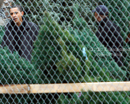 Chicago, IL - December 14, 2008 -- United States President-elect Barack Obama looks over a selection of Christmas trees for his family on Sunday, December 14, 2008, in Chicago, Illinois..Credit: Frank Polich - Pool via CNP