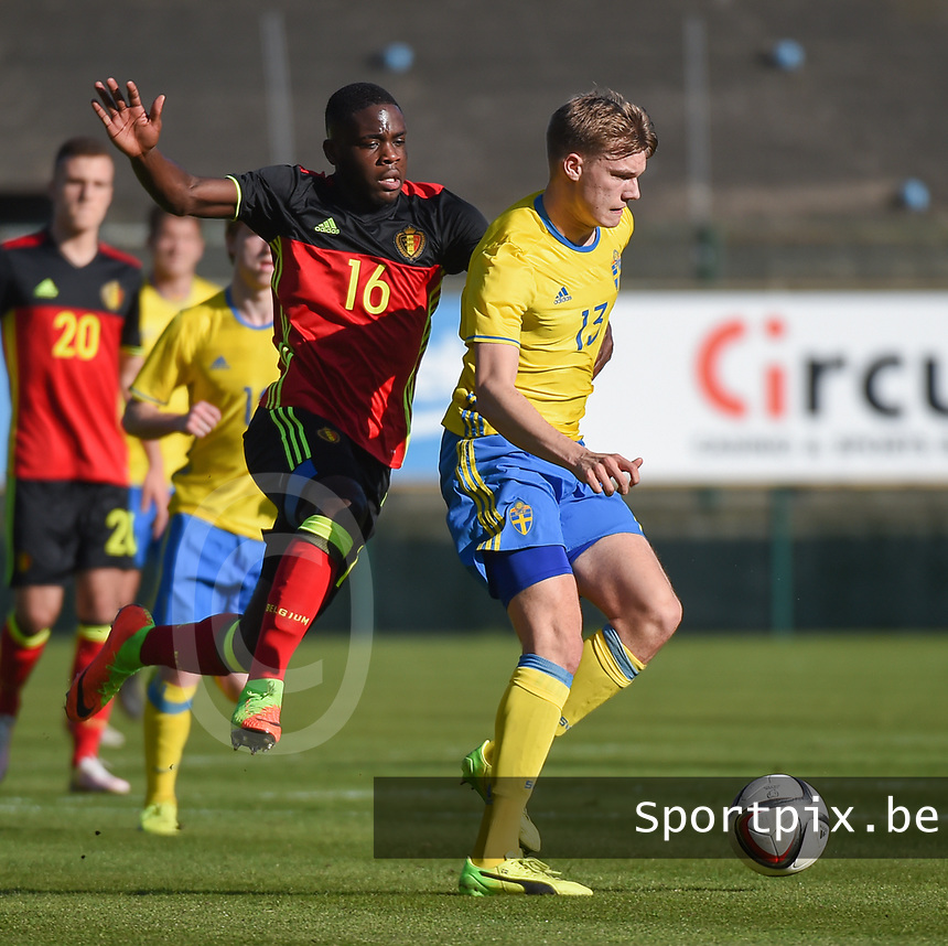 20170323 - BEVEREN , BELGIUM : Swedish Svante Inglesson (R) and Belgian Orel Mangala (L) pictured during the UEFA Under 19 Elite round game between Sweden U19 and Belgium U19, on the first matchday in group 7 of the Uefa Under 19 elite round in Belgium , thursday 23 th March 2017 . PHOTO SPORTPIX.BE | DIRK VUYLSTEKE