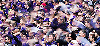 Husky Fans wave their hats prior to kickoff.