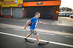 © Joel Goodman - 07973 332324. 15/10/2017 . Manchester , UK . Athlete CRAIG KEATLEY wearing flippers , taking part in the Greater Manchester Half Marathon in Old Trafford . Photo credit : Joel Goodman