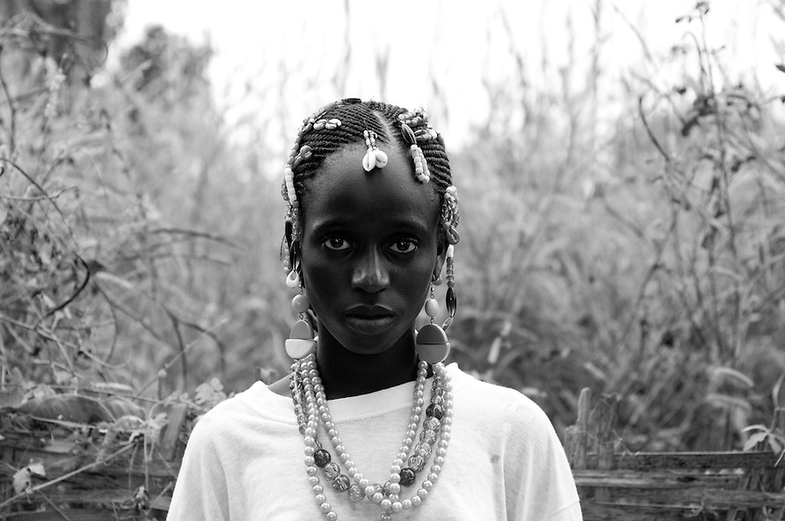UNICEF/Senegal/Shryock/2009.Khadidatou Balde insisted on staying in school when her parents told her she must drop out to help at home. UNICEF works with communities to educate parents about the importance of allowing theri children to stay in school.