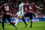 Marcelo Vieira Da Silva (c) of Real Madrid fights for the ball with Cristian Rivera Hernandez of SD Eibar during the La Liga 2017-18 match between Real Madrid and SD Eibar at Estadio Santiago Bernabeu on 22 October 2017 in Madrid, Spain. Photo by Diego Gonzalez / Power Sport Images