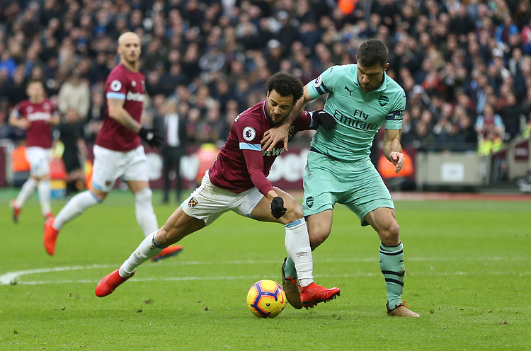 West Ham United's Felipe Anderson and Arsenal's Sokratis Papastathopoulos<br /> <br /> Photographer Rob Newell/CameraSport<br /> <br /> The Premier League - West Ham United v Arsenal - Saturday 12th January 2019 - London Stadium - London<br /> <br /> World Copyright © 2019 CameraSport. All rights reserved. 43 Linden Ave. Countesthorpe. Leicester. England. LE8 5PG - Tel: +44 (0) 116 277 4147 - admin@camerasport.com - www.camerasport.com