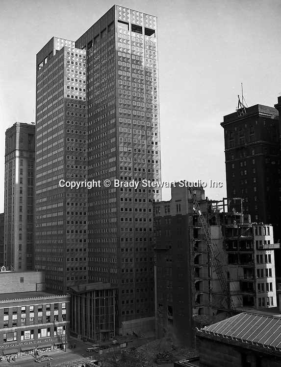 Pittsburgh PA:  The demolition of the People's Gas Building in 1953 to make room for the Market Square Park which opened in 1955.  Alcoa Building in the background.