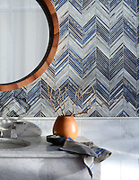 Ombre Chevron, a handmade jewel glass mosaic shown in Lavastone, Zircon and Alabaster is part of the Shades of Gray Collection by Sara Baldwin for New Ravenna.<br />