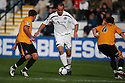 Robbie Matthews of Newport takes on the Cambridge defence during the Blue Square Bet Premier match between Cambridge United and Newport County at the Abbey Stadium, Cambridge  on 25th September, 2010.© Kevin Coleman