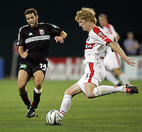 9 April 2005.   Jim Curtin (5) of the Chicago Fire punts the ball away from DC United midfielder Ben Olsen (14) at RFK Stadium in Washington, DC.