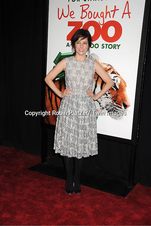 """Parker Posey in Rachel Comey lasce dress attends The New York Screening of """"We Bought A Zoo"""" on December 12, 2011 at The Ziegfeld Theatre in New York City. The movie stars Matt Damon, Scarlett Johansson, Thomas Haden Church, Patrick Fugit, Colin Ford, Elle Fanning and John Michael Higgins."""