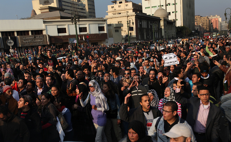 Protesters march down Ramsis Street in downtown Cairo, Egypt, Jan. 25, 2011. The day was an official holiday in honor of the achievements of police, but thousands of demonstrators came out to protest corruption, unemployment and police torture.