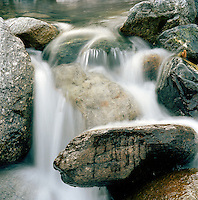 Waterfall flowing over boulders, Ischgl, Austrian Tirol, Austria.