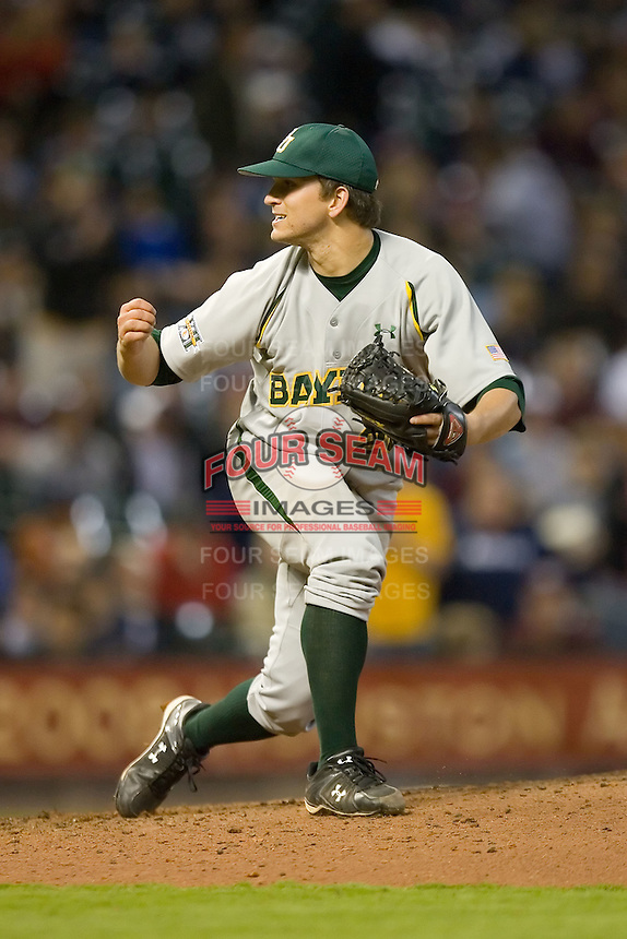 Relief pitcher Willie Kempf #26 of the Baylor Bears follows through on his deliver versus the UCLA Bruins  in the 2009 Houston College Classic at Minute Maid Park February 28, 2009 in Houston, TX.  The Bears defeated the Bruins 5-1. (Photo by Brian Westerholt / Four Seam Images)