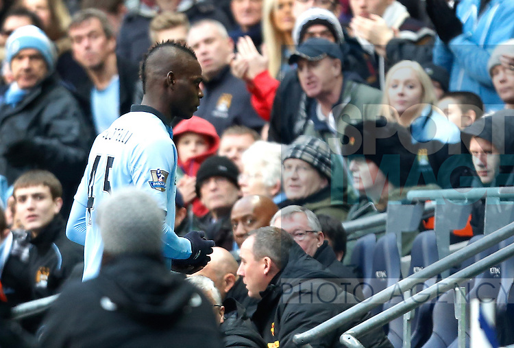 Mario Balotelli of Manchester City walks down the tunnel after being substituted and is watched by manager Sir Alex Ferguson of Manchester United - Barclays Premier League - Manchester City v Manchester United - Etihad Stadium - Manchester - England - 12th December 2012