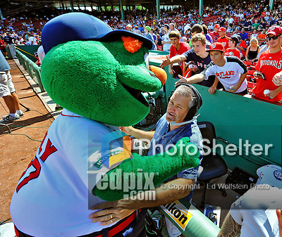 9 June 2012: Boston Red Sox Mascot Wally hugs a cameraman prior to a game against the Washington Nationals at Fenway Park in Boston, MA. The Nationals defeated the Red Sox 4-2 in the second game of their 3-game series. Mandatory Credit: Ed Wolfstein Photo