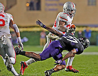 Ohio State Buckeyes running back Carlos Hyde (34) avoids Northwestern Wildcats cornerback Matthew Harris (27) in the fourth quarter of their game at Ryan Field in Evanston, IL on October 5, 2013. Columbus Dispatch photo by Brooke LaValley)