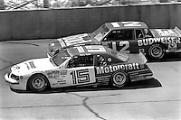 BROOKLYN, MI - AUGUST 11: Ricky Rudd (#15 Bud Moore Ford) leads Neil Bonnett (#12 Junior Johnson Chevrolet) during the Champion Spark Plug 400 NASCAR Winston Cup race at the Michigan International Speedway near Brooklyn, Michigan, on August 11, 1985.