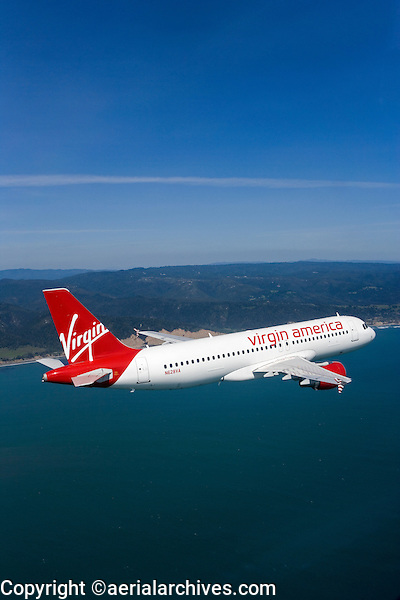 aerial photograph of N628VA, Virgin America Airlines Airbus A320-214 over the Pacific Ocean along the San Mateo County shoreline, California