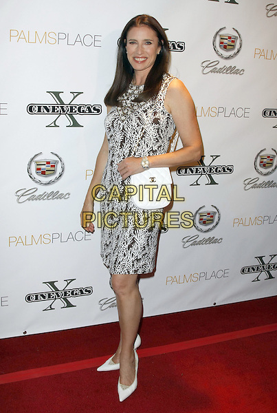 MIMI ROGERS.CineVegas 10th Anniversary Party at the Palms Place Pool, Las Vegas, Nevada, USA, 13 June 2008.full length white Chanel bag and black print dress shoes pointy.CAP/ADM/MJT.©MJT/Admedia/Capital Pictures