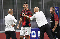 Zlatan Ibrahimovic of AC Milan argues with Stefano Pioli coach of AC Milan while she was substituted during the Serie A football match between AC Milan and Bologna FC at stadio Giuseppe Meazza in Milano ( Italy ), July 18th, 2020. Play resumes behind closed doors following the outbreak of the coronavirus disease. <br /> Photo Image Sport / Insidefoto