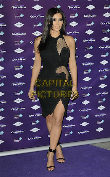 Kim Kardashian.attended the Kim Kardashian's Quick Trim Essentials Kit launch party, St Pancras Renaissance London Hotel, Euston Rd., London, England, UK, .18th May 2012..full length  black cut out sheer mesh dress panel fishnet ankle strap open toe shoes sandals .CAP/CAN.©Can Nguyen/Capital Pictures.
