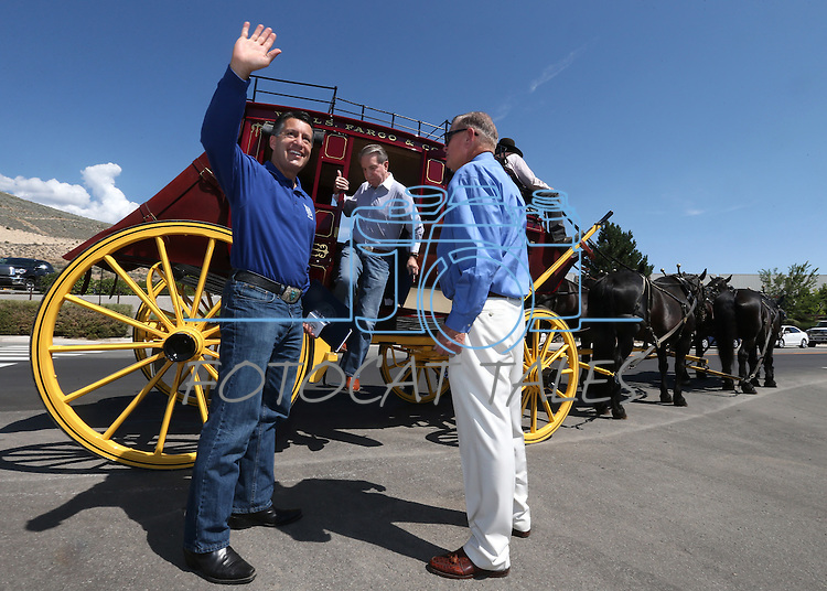 Retired Judge Roby Willis, right, greets Gov. Brian Sandoval and Mayor Bob Crowell at the ribbon-cutting ceremony at the NV150 Fair at Fuji Park, in Carson City, Nev., on Thursday, July 31, 2014.<br /> Photo by Cathleen Allison