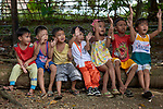 Children in Mt. Heights, Philippines, respond as they listen to Maria Jessica Cicillo, a deaconess who works as a Christian educator for a nearby United Methodist Church.